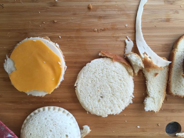I then cut the sandwich meat and cheese out of circles.