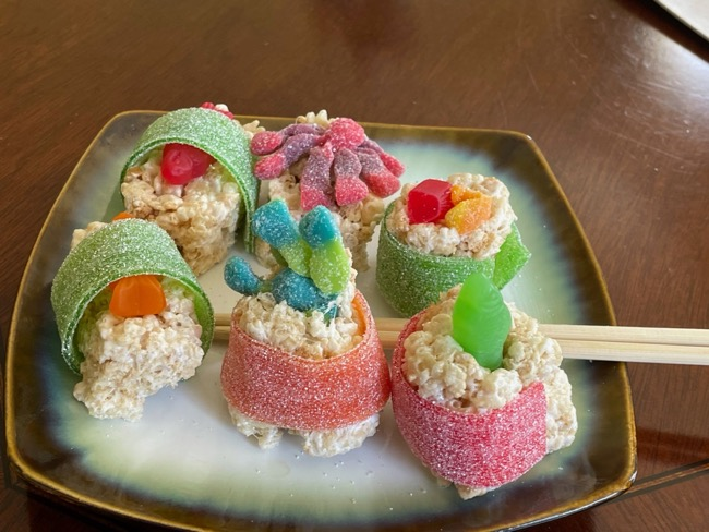 candy sushi on a plate with chopstickes