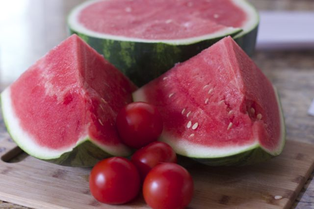 Fresh from Florida Tomatoes, watermelon onions and cheese create this refreshing Summer Tomato Watermelon salad.