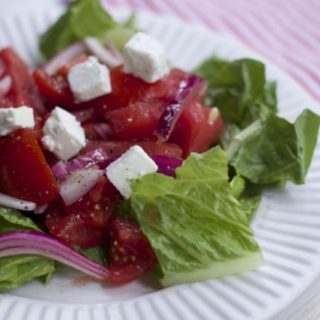 Fresh from Florida Tomatoes, watermelon onions and cheese create this refreshing Tomato Watermelon summer salad.