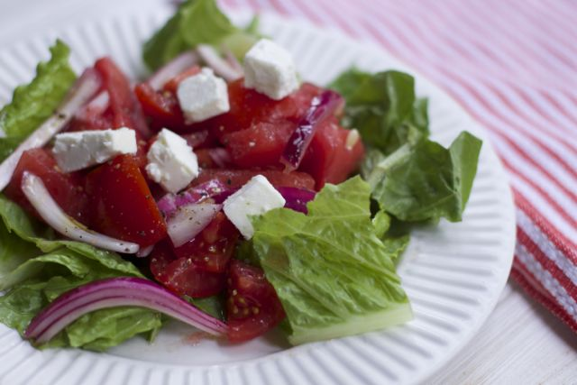 Fresh from Florida Tomatoes, watermelon onions and cheese create this refreshing Tomato Watermelon salad.