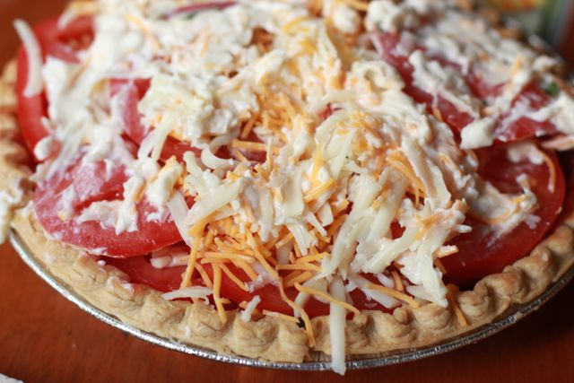 Tomato Pie Recipe:  Indulge in a Southern Classic Tomato Pie Recipe that is the ideal vegetarian main dish, or a fun side dish your entire family will enjoy!