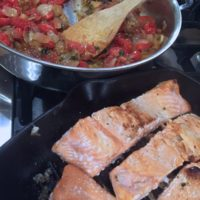 Salmon and melting tomatoes