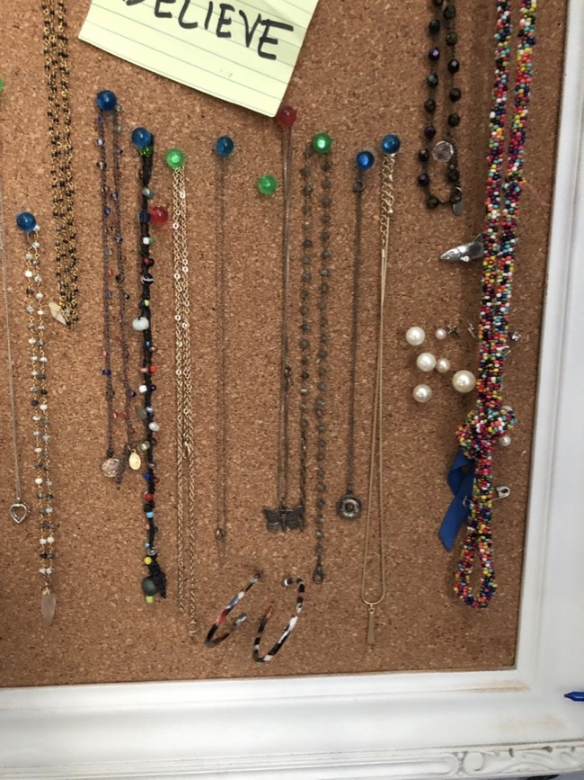 repurpose old picture frameusing thumb tacks for necklaces