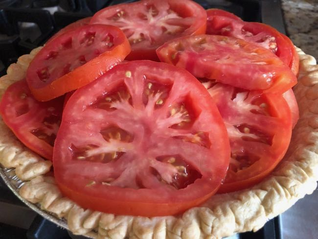 layering tomatoes for pie