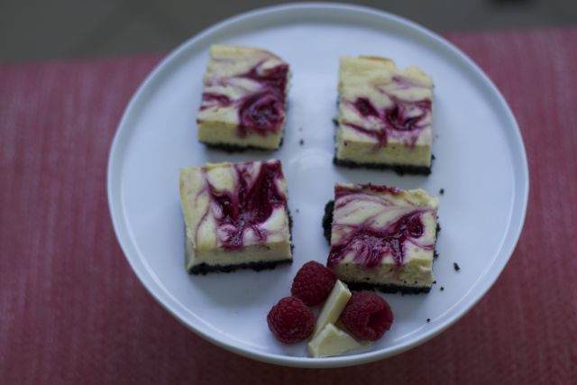 Our Raspberry White Chocolate Cheesecake Bars are the perfect simple but decadent treat to share with friends and family!  Make this recipe to impress guests!