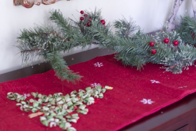 adding garland to centerpiece