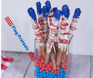 patriotic food ideas like these chocolate covered flag pretzels are ideal for fourth of july parties.
