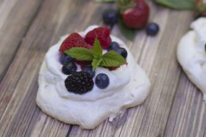 pavlova with mixed berries a great fourth of july dessert