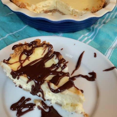 cheesecake pie slice with chocolate sauce